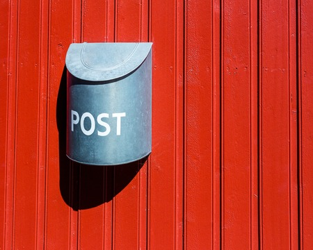 red post box: Red wood wall vounted post box