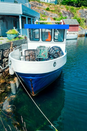 Vintage fishing boat in harbor in Norway Stock Photo