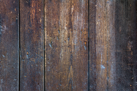 Worn brown grunge wooden planking as background