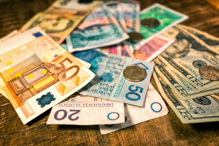 Background from paper money of the different countries Stock Photo