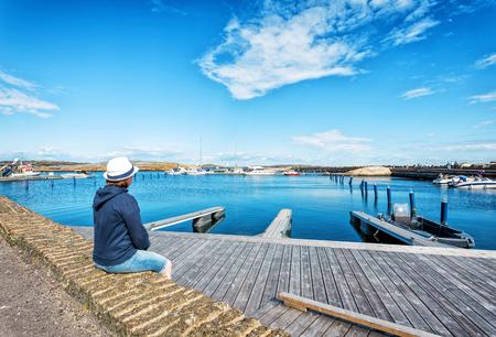 ende: Girl in hat in seashore view in Verdens Ende, Norway