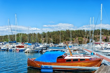 Fisherman boat with ropes and float. Norway. Wooden boat made fast to the pier. Stock Photo