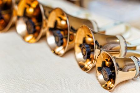 Golden handbells ready to play close up