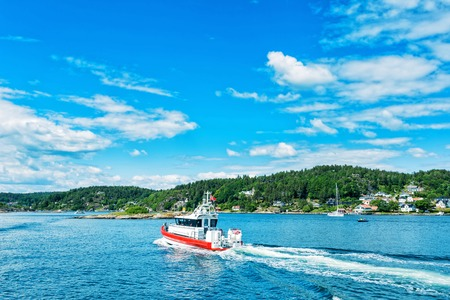 Boat on Norwegian fjord Stock Photo
