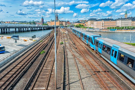Railway tracks and trains in main train station in Stockholm, Sweden in sunset Stock Photo