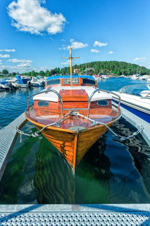The old wooden boat in the port Stock Photo