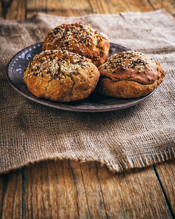 Breads on plate on wooden table. Close up Stock Photo
