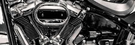 shiny motorbike engine, black and white horizontal, panorama, panoramic