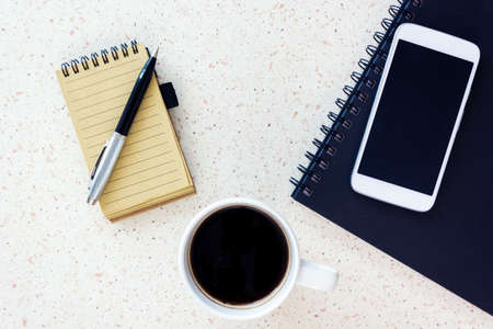desktop mock up with smartphone coffee notebook and pen, white and blue home office remote working Banque d'images