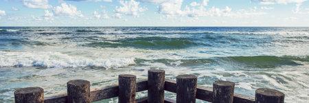 horizontal line of sea waves and wooden balls horizontal, panorama