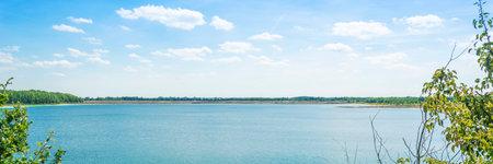 horizontal landscape of blue lake on summer time horizontal, panorama