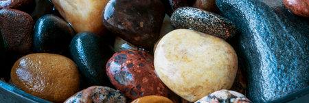 shiny wet stones in bowl horizontal, panorama