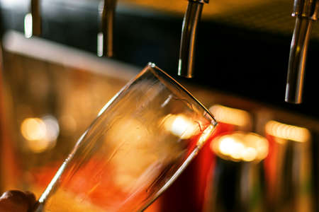 empty craft beer glass on blurred background close up bar