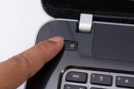 shut down: finger push on power button