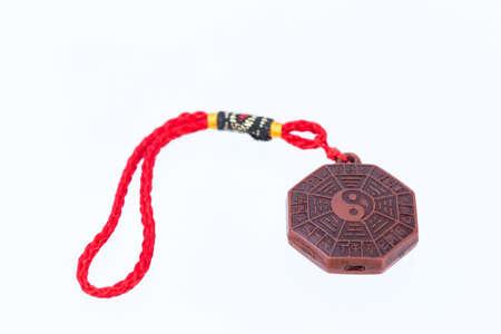 opposites: yinyang amulet on white background
