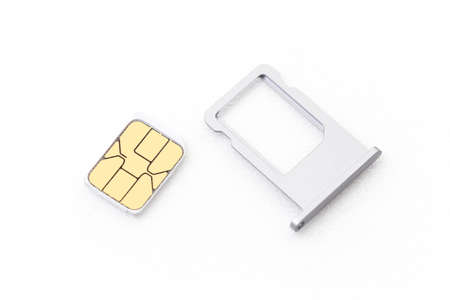 nano: nano sim card with tray for cellphone on white background