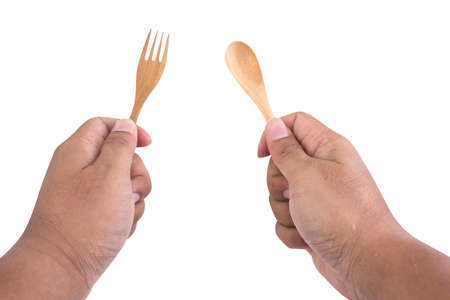 fork in path: hand hold spoon and fork on white background