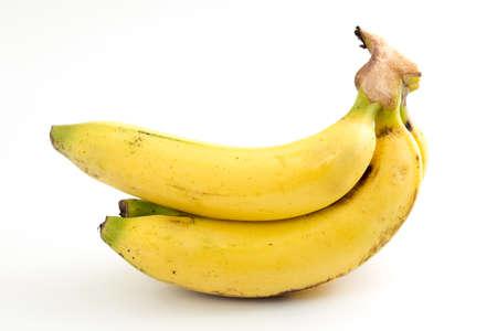 banana skin: Bunch of bananas on white background