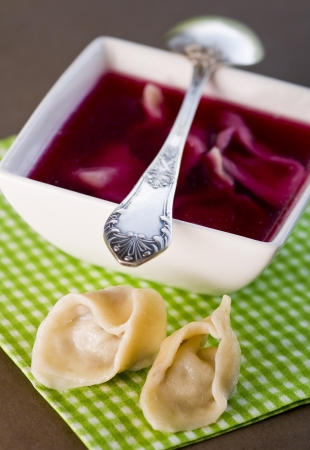 Red borscht with dumplings photo