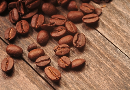 Coffee beans on the wooden board photo