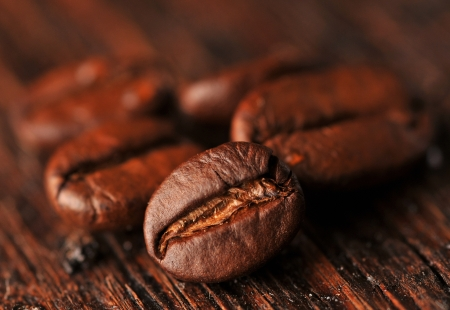Coffee beans on the wooden board Stock Photo - 16963462