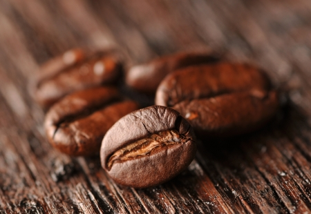 Coffee beans on the wooden board Stock Photo - 16963454