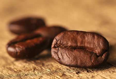 Coffee beans on the wooden board Stock Photo - 16963468