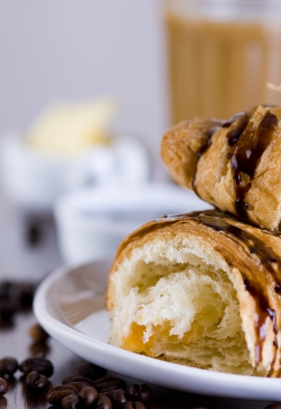 Chocolate croissant with coffee photo