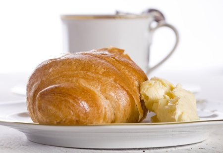 Croissant with cup of coffee photo