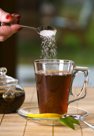 Glass of tea with sugar photo