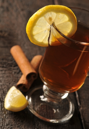 Warming tea with lemon and cinnamon photo