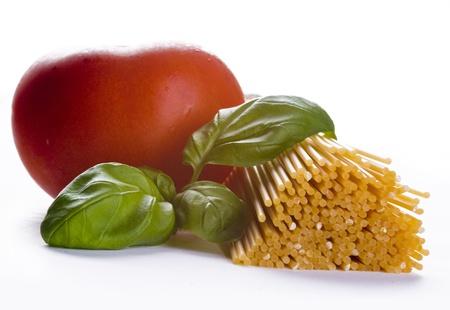 Spaghetti with fresh tomato and basil photo