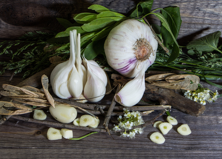Still life with garlic on a wooden background Stock Photo