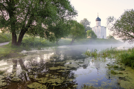 The Church of the Intercession on the Nerl, sunrise and fog. Vladimir Region, Bogolyubovo. Golden Ring of Russia