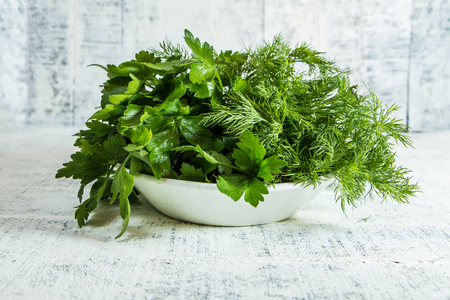 White parsley on white wooden table