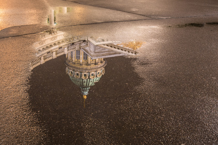 Kazan Cathedral Petersburg. Reflection of the cathedral in a puddle. Russia