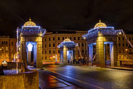 Russia, Saint-Petersburg, 30, December, 2017: View of the Lomonosov Bridge on the winter evening. New Year and Christmas decorations Petersburg