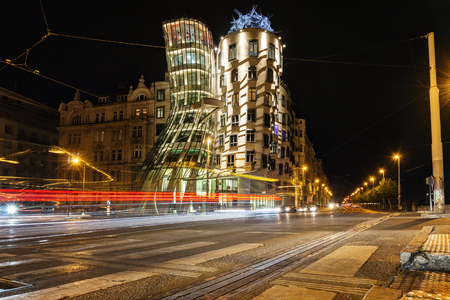Prague, Czech Republic, April 22, 2019 - Dancing house in the evening, the lights of cars. Editorial