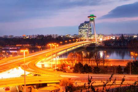 Bratislava, Slovakia: 25, nowember, 2019 -  bridge over the Danube River in Bratislava, Bridge SNP. Evening view on the  bridge and the UFO observation deck at dusk