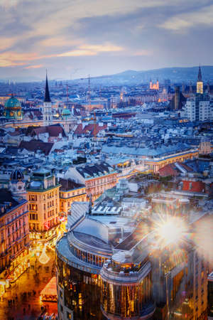 Austria, Vienna: 24, nowember, 2019 -  View from the main cathedral of St. Stephen to the city, twilight. Evening view of the city of Vienna, the lights of the night city. View from the roof. Editorial