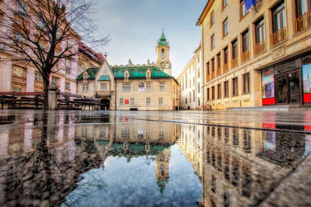 Bratislava, Slovakia- walk in the old city of Bratislava, view of the city.View onb the Old town hall in reflection Editorial