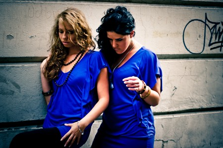 Two women dressed in blue photo