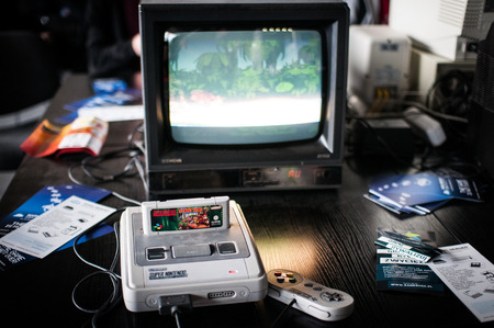 Poznan Games Fair Game Arena  PGA  on the picture The Super Nintendo Entertainment System  also known as the Super NES, SNES or Super Nintendo  is a 16-bit video game console developed by Nintendo that was released in 1990 in Japan, 1991 in North America, Stock Photo - 26627129