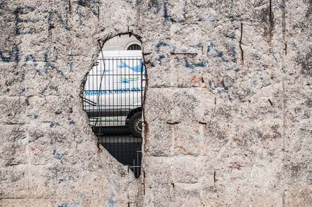 Last remains of the Berlin wall along the ex headquarters of the Gestapo and the SS in Niederkirchnerstrasse 8. Pictured a hole in the wall.