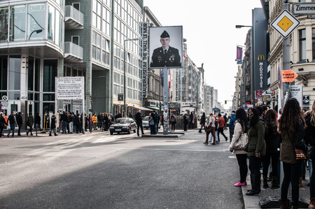 east end: Checkpoint Charlie in Berlin was the crossing point Between East and West Berlin sectors during the Cold War. In the photo, visitors people. Editorial