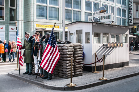 Checkpoint Charlie in Berlin was the crossing point Between East and West Berlin sectors during the Cold War. In the photo, visitors people. Editorial