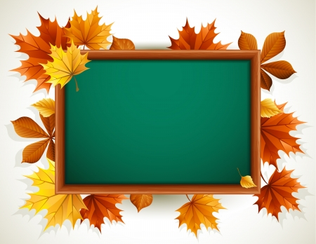 wooden blackboard with autumn leaves