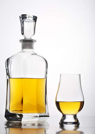 whisky glass: isolated whiskey glass and bottle set