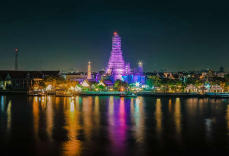 contruction: Night time view of Wat Arun Temple temple of dawn across Chao Phraya River under contruction Stock Photo