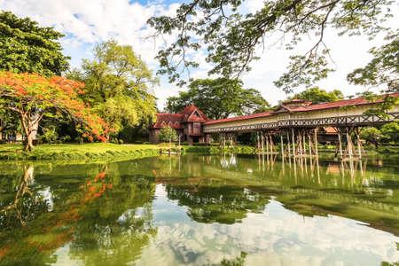 chan: Vintage cross bridge of Sanam Chan Palace against blue sky Editorial